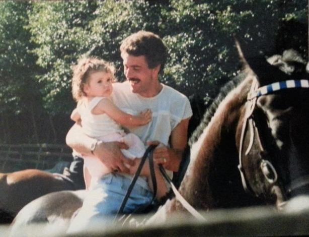 My Dad with his horse and me! Circa the mid 80's. Even then, you can tell I was not a fan of horses.