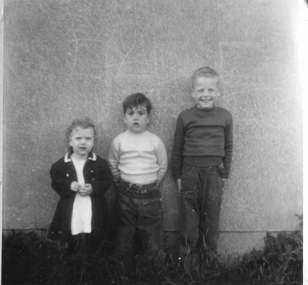 My Dad is the adorable guy in the middle. That's his older bro and younger sister on either side of him.